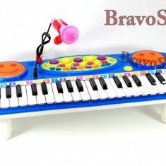 Instrumente muzicale copii - Orga electronica de jucarie / Orga pentru copii cu microfon si lumini